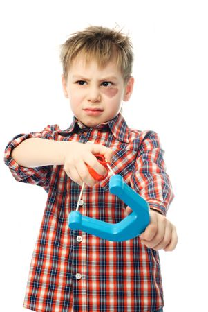 naughty boy with a bruise under his eye holding a slingshot and looking at something Stock Photo - 4321669