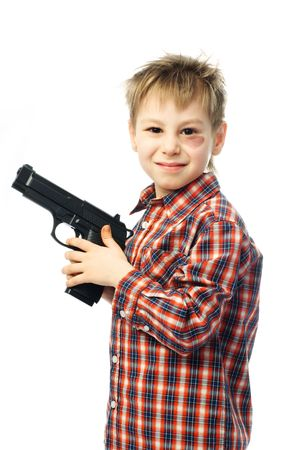 little angry boy with a bruise under his eye holding a gun photo