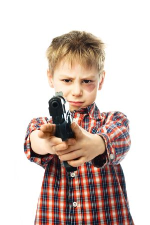 little boy with a bruise under his eye holds a gun and aims at us Stock Photo - 4321666