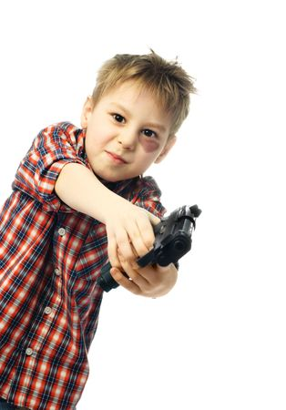 little boy with a bruise under his eye holding a gun and aiming at us photo