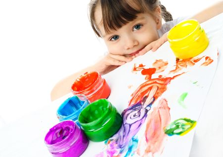 cute little girl sitting by the table and painting with finger paints Stock Photo - 4358361