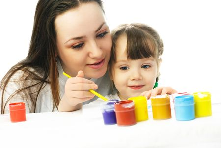 young mother teaching her little daughter painting with watercolor Stock Photo - 4358398