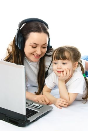 young mother and her little daughter with a laptop on the floor Stock Photo - 4358395