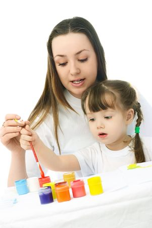 young mother teaching her daughter painting with watercolor Stock Photo - 4358384