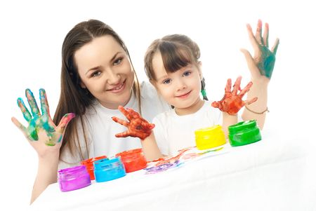 young mother and her daughter painting with finger paints and showing us their  fingers Stock Photo - 4358383