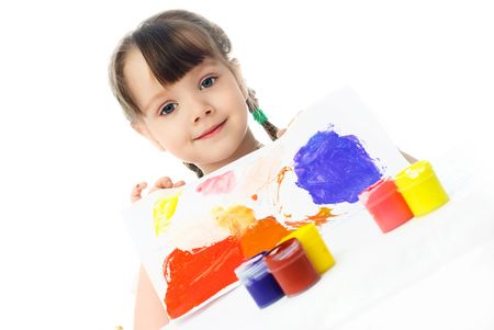 cute little girl sitting by the table and showing us the picture she has painted with watercolor Stock Photo - 4358343