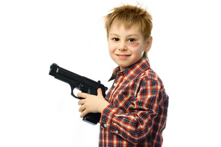 cheerful boy with a bruise under his eye holding a gun in his hands photo