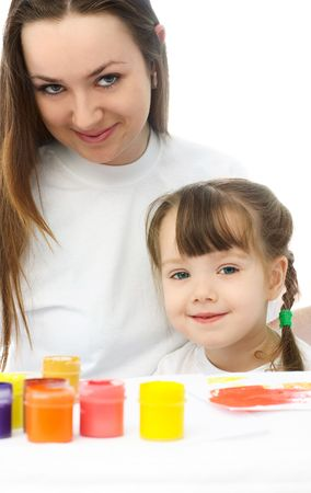 young mother and her daughter sitting by the table and painting with watercolor Stock Photo - 4358447