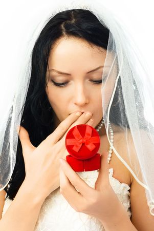 surprised young beautiful bride looking at the wedding rings photo