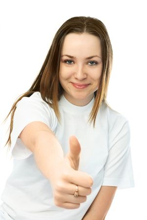 beautiful young woman with her thumb up against white background Stock Photo - 4373496