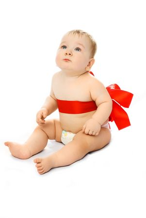 adorable baby tied up with a red ribbon isolated against white background Stock Photo - 4388472