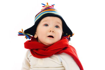 adorable displeased baby wearing warm winter clothes feels cold photo