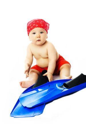 cute baby wearing summer clothes with blue flippers ready for the beach season photo