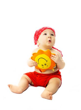 summer clothes: cute dreamy ten months old baby wearing summer clothes with a toy Sun in his hands Stock Photo