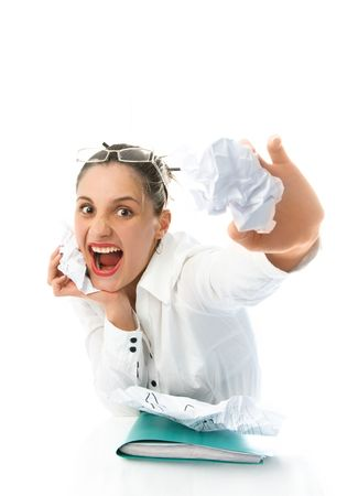 angry young businesswoman shouting and throwing paper at us Stock Photo - 4483370