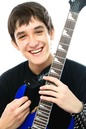 hardrock: happy laughing young man with a guitar against white background Stock Photo