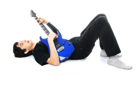 hardrock: portrait of a young man playing the guitar on the floor, isolated against white background