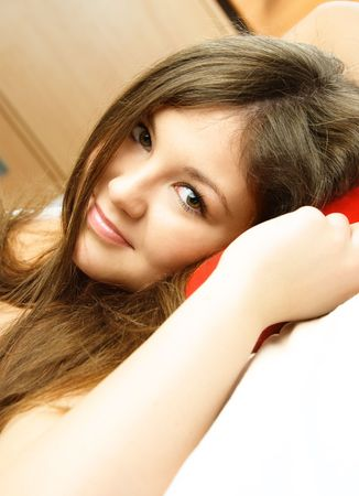 beautiful young woman having rest in her bed at home Stock Photo - 4520316