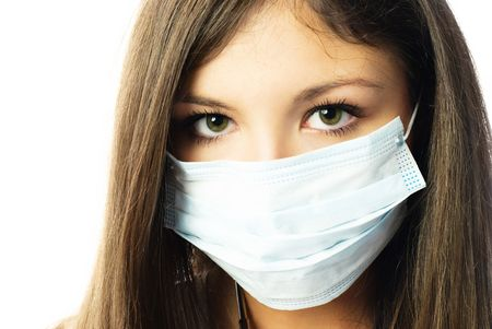 young beautiful hospital worker wearing protective mask against white background