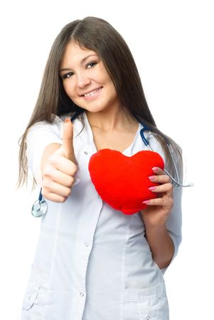 beautiful young cardiologist with a heart shaped pillow and her thumb up photo
