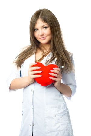 beautiful young cardiologist with a heart shaped pillow in her hands photo