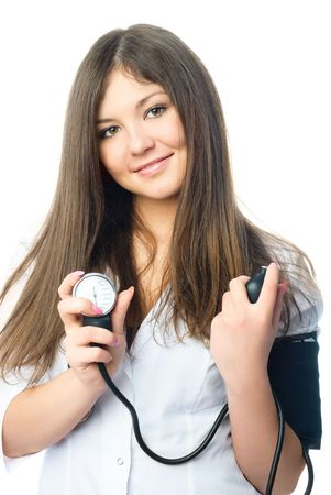 young beautiful doctor dressed in white uniform measuring her blood pressure photo