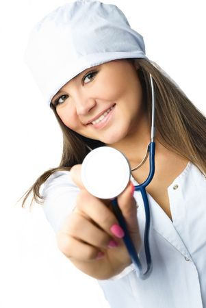 beautiful young doctor wearing white uniform using a stethoscope for a patient examination photo
