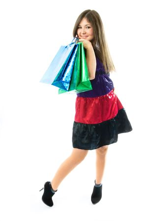 beautiful young woman holding shopping bags against white background photo