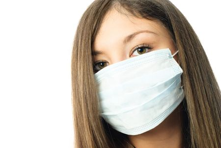 young beautiful hospital worker wearing protective mask against white background photo