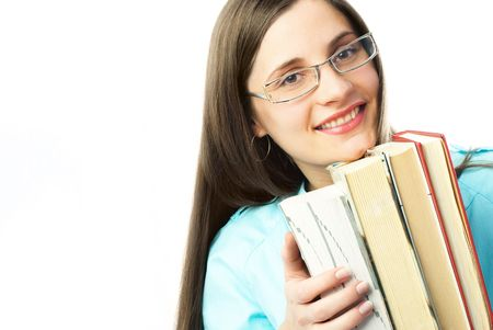 portrait of a happy young student holding a lot of books and smiling photo