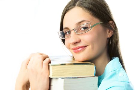 happy young beautiful student holding books and looking at us with a smile photo