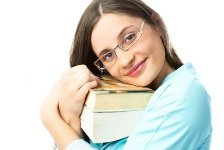 happy young beautiful student holding many books and looking at us with a smile photo