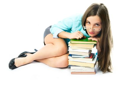 librarian: beautiful young student on the floor with a lot of books