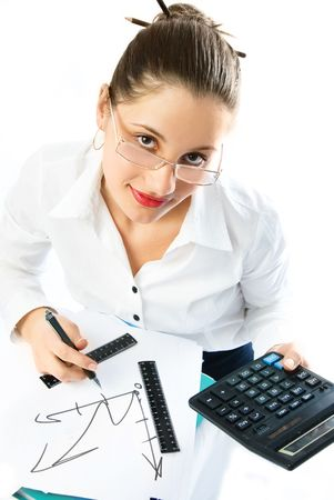 beautiful young businesswoman with a calculator drawing a scheme photo