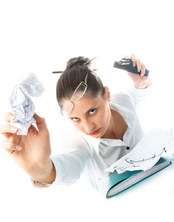 humorous portrait of an angry young businesswoman throwing paper at us Stock Photo - 4519878