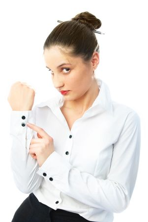 portrait of a serious young businesswoman getting dressed Stock Photo - 4519951