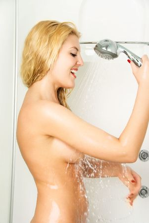 herself: beautiful happy young blond woman talking a shower