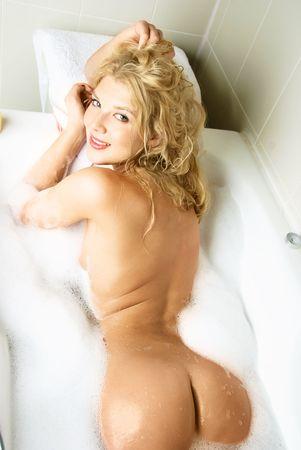 girl sexy nude: beautiful sexy woman taking a relaxing bath with foam