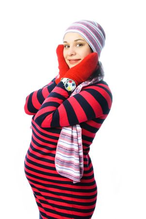 beautiful young pregnant woman wearing warm winter clothes against white background Stock Photo