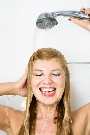 female sexuality: beautiful happy young woman taking a shower and washing her hair