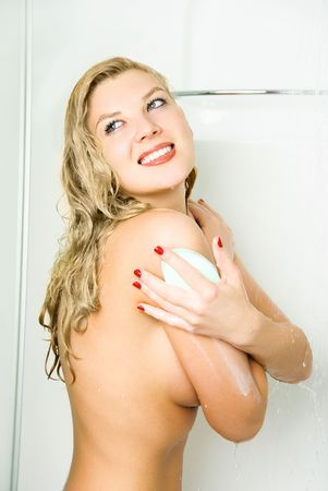 herself: portrait of a beautiful young happy woman taking a shower