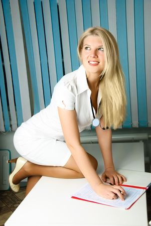 portrait of a beautiful young doctor with a stethoscope in her office  Stock Photo - 4695069