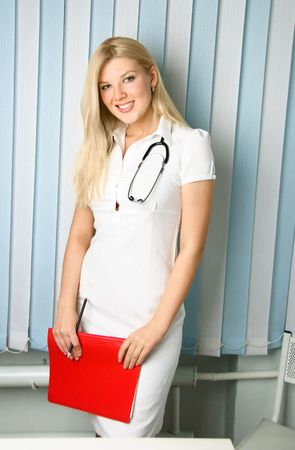 portrait of a young beautiful doctor with a stethoscope in the office Stock Photo - 4695092
