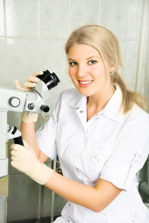beautiful young doctor with gynecological equipment in the office photo