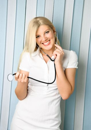 portrait of a young beautiful doctor with a stethoscope in the office photo
