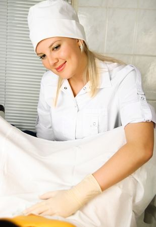 portrait of a young gynecologist examining a patient in her office   Stock Photo - 4704044