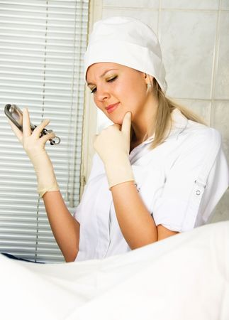 portrait of a young thoughtful gynecologist examining a patient in her office   photo
