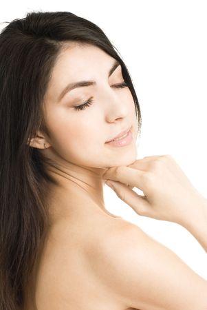 portrait of a beautiful young brunette woman touching her cheek photo