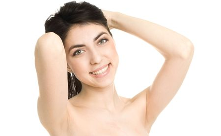 underarms: portrait of a beautiful happy brunette girl against white background