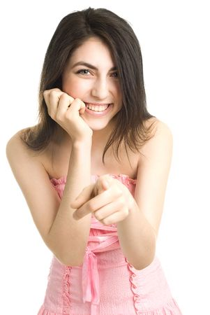 giggle: beautiful laughing girl points at us, isolated against white background